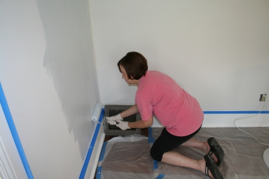 My mom touching up the corners and edges of the Guest Bedroom