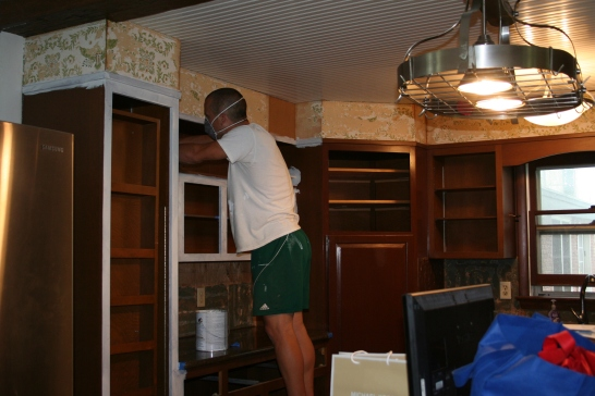 David priming the kitchen cabinets