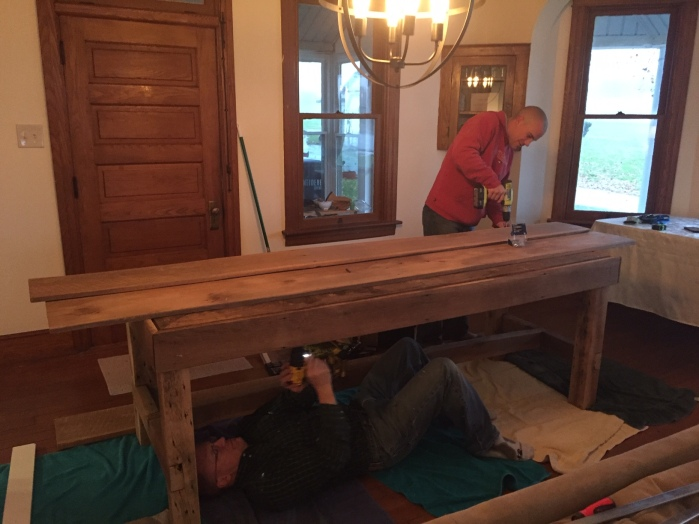 Bill and David pre-drilling the screw holes for the table top.
